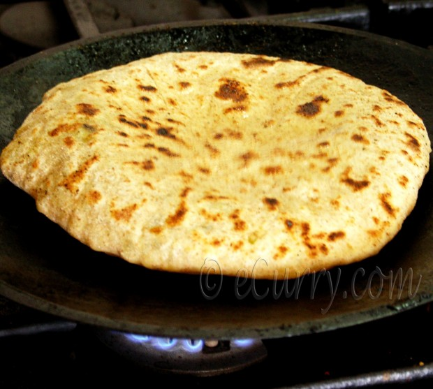Cook all the paranthas in the same way as above and cool them in a ...